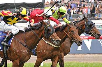 Kirramosa (outside) wins from Zanbagh (middle) and Solicit